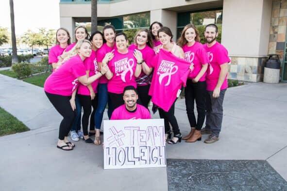 Group of Scorpion employees wearing pink shirts